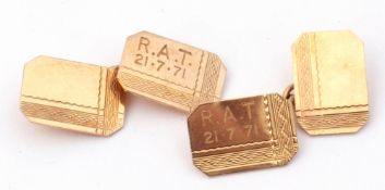 """Pair of 9ct gold cuff links of rectangular canted form with floral engine turned decoration and """"R."""
