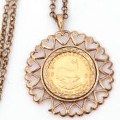 1981 1/10 gold Krugerrand in a 9ct gold heart framed pendant mount (a/f) suspended on a 375