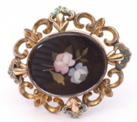 Antique pietro-dura gold filled brooch, the centre with a stone floral spray in pink and green,