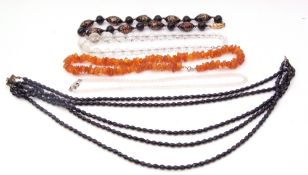 Mixed Lot: Baltic amber fragment necklace, two crystal necklaces, black jet type necklace together
