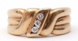 9ct gold and diamond ring, centring a line of three small brilliant cut diamonds between textured
