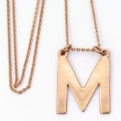 """9ct gold """"M"""" pendant suspended from a 9ct stamped chain, 4.4gms"""