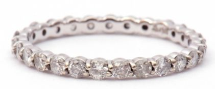 Modern 14K stamped diamond full eternity ring, size K, one diamond missing