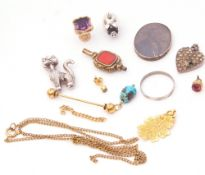 Mixed Lot: antique watch key, a white metal cat pendant, a modern pig pendant etc