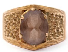9ct gold and smoky quartz ring, the oval faceted smoky quartz in a coronet setting raised between
