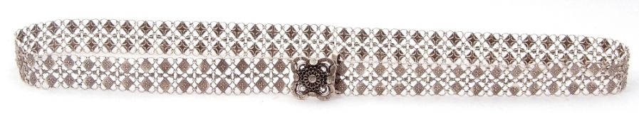 Chinese style white metal belt comprising small circular links decorated with chased geometric
