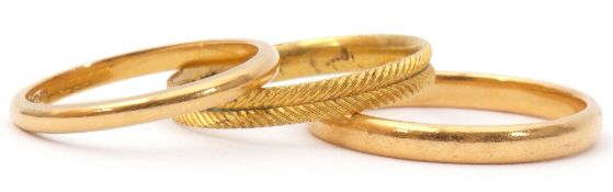 Mixed Lot: two 22ct gold wedding rings of plain polished design, 6.6gms, together with a gilt