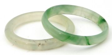 Mixed Lot: pale green jade bangle, 6cm diam (interior) together with a pale celadon quartz bangle (