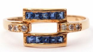 Modern sapphire and diamond ring, a rectangular open work design set with calibre cut sapphires