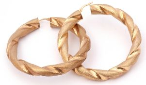 Pair of large circular 9ct gold rope twist earrings of burnished design, 6cm diam, 12.1gms