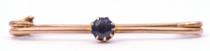 Antique sapphire set pin brooch, the circular shaped sapphire multi-claw set and raised on a