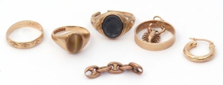 """Mixed Lot: 9ct gold Zodiac pendant """"Scorpio"""", a 9ct gold tiger's eye ring, a 9ct gold haematite ring"""