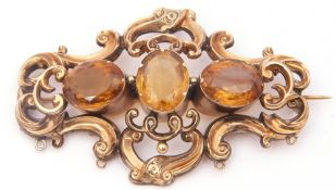Large antique citrine three stone brooch, the oval cut stones claw set in cut down settings,