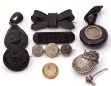 Mixed Lot: Victorian carved jet pendant, an oval shaped mourning pendant with plaited hair panel