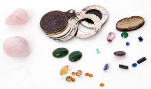 Small quantity of loose gem stones to include a synthetic sapphire, a natural peridot, two oval