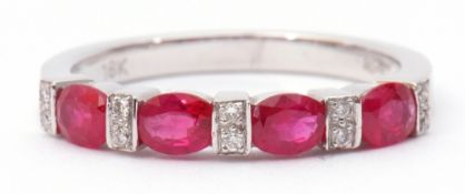 Modern ruby and diamond half-hoop ring, a design featuring 4 oval faceted rubies between 5 pairs