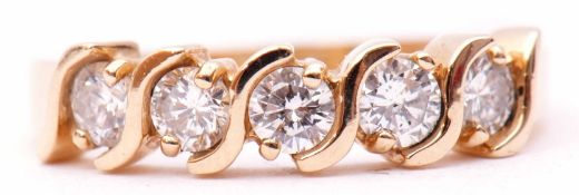 "Five stone diamond ring, stamped 14K, featuring five round brilliant cut diamonds set between ""S"""