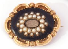 Early Victorian gold, black enamel and seed pearl mourning brooch, the centre with a glazed panel of