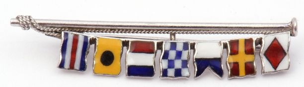 White metal and enamel flag signalling brooch featuring seven translucent enamel flags attached to a