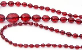 Vintage cherry amber faceted bead necklace, a single row of graduated oval beads, .5cm to 2.5cm