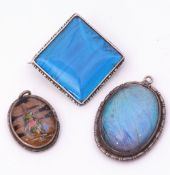 Mixed Lot: sterling mounted butterfly wing brooch of square form, together with two oval shaped