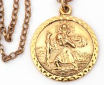 9ct gold circular St Christopher, 25mm diam, London 1972, suspended from an oval link chain