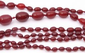 Vintage cherry amber bead necklace, a single row of graduated oblong shaped beads, 1cm to 3cm