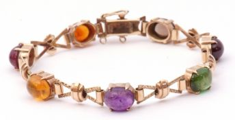 Cropp & Farr 9ct gold bracelet set with various cabochon gems to include amethyst, amber, peridot