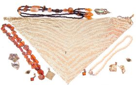 Mixed Lot: modern amber to include a bead necklace, bracelet and earrings, brooches, simulated