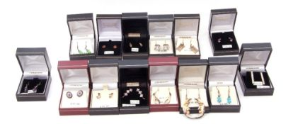 Fourteen boxed pairs of modern white metal (sterling) earrings to include cubic zirconia and crystal
