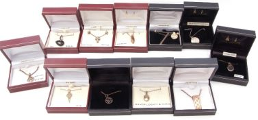 Eleven boxed white metal (sterling) modern pendants to include blue topaz, onyx and cubic zirconia