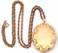Modern 9ct gold oval shaped locket with a scroll border, verso with a burnished finish, 4 x 3cm,
