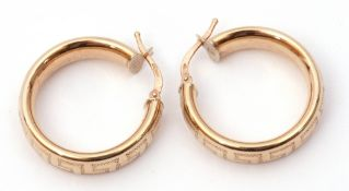 Pair of hoop earrings with a Greek key pattern and wire fittings, stamped 375, 3.2gms
