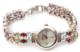 925 stamped ladies quartz wrist watch, the bracelet set with multi-coloured stones
