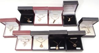 Ten boxed white metal (sterling) modern pendants to include zodiac and cubic zirconia examples