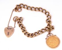 9ct gold curb link bracelet with heart padlock and safety chain fitting, suspending an Edward VII