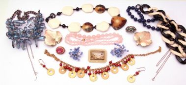 Large quantity of costume jewellery to include necklaces, brooches etc