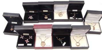 Ten boxed white metal (sterling) pendants to include cubic zirconia, a zodiac example etc
