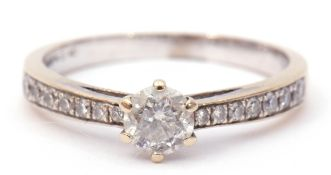 Precious metal diamond set ring, the central brilliant cut diamond 0.25ct approx in a coronet