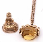Mixed Lot: antique swivel faceted citrine fob in a yellow metal scroll mount suspended from a yellow