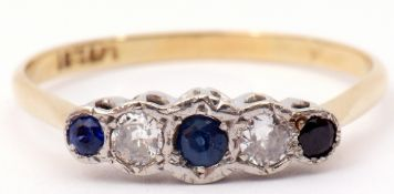 Sapphire and diamond five stone ring featuring 3 graduated matched sapphires and 2 round diamonds,