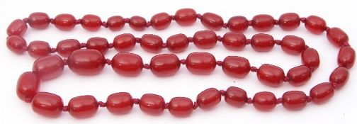 Vintage cherry amber bead necklace, a single row of graduated drum shaped beads, 1.5cm to 2.5cm, g/w