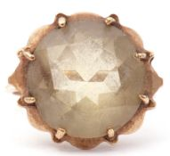 9ct gold and yellow stone ring, the circular faceted stone multi-claw set and raised in a basket