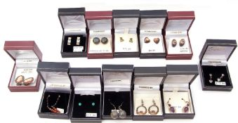 Twelve boxes of white metal (sterling) earrings to include amethyst, blue topaz and laboradorite