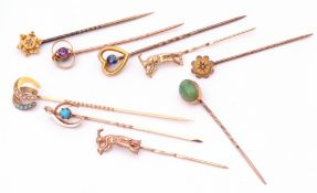 Mixed Lot: nine vintage stick pins, the finials with small diamond, amethyst, turquoise and sapphire