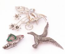 "Vintage silver stamped and marcasite bird brooch, a parrot brooch, paste set and stamped ""silver"","