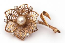 9ct gold and seed pearl brooch, a pierced design of a flower head highlighted with graduated seed