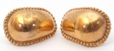 Pair of 9ct gold hollow earrings, a plain polished oval design, each with beaded borders and post