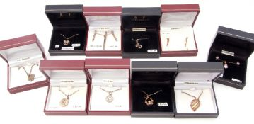 Ten boxed white metal (sterling) modern pendants of various designs