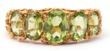 9ct gold five stone peridot ring, featuring five graduated oval cut peridots, claw set in carved